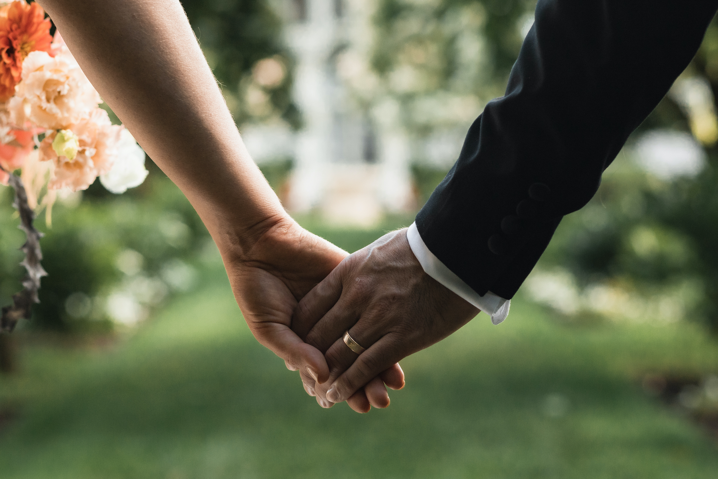 detail shot of couple holding hands