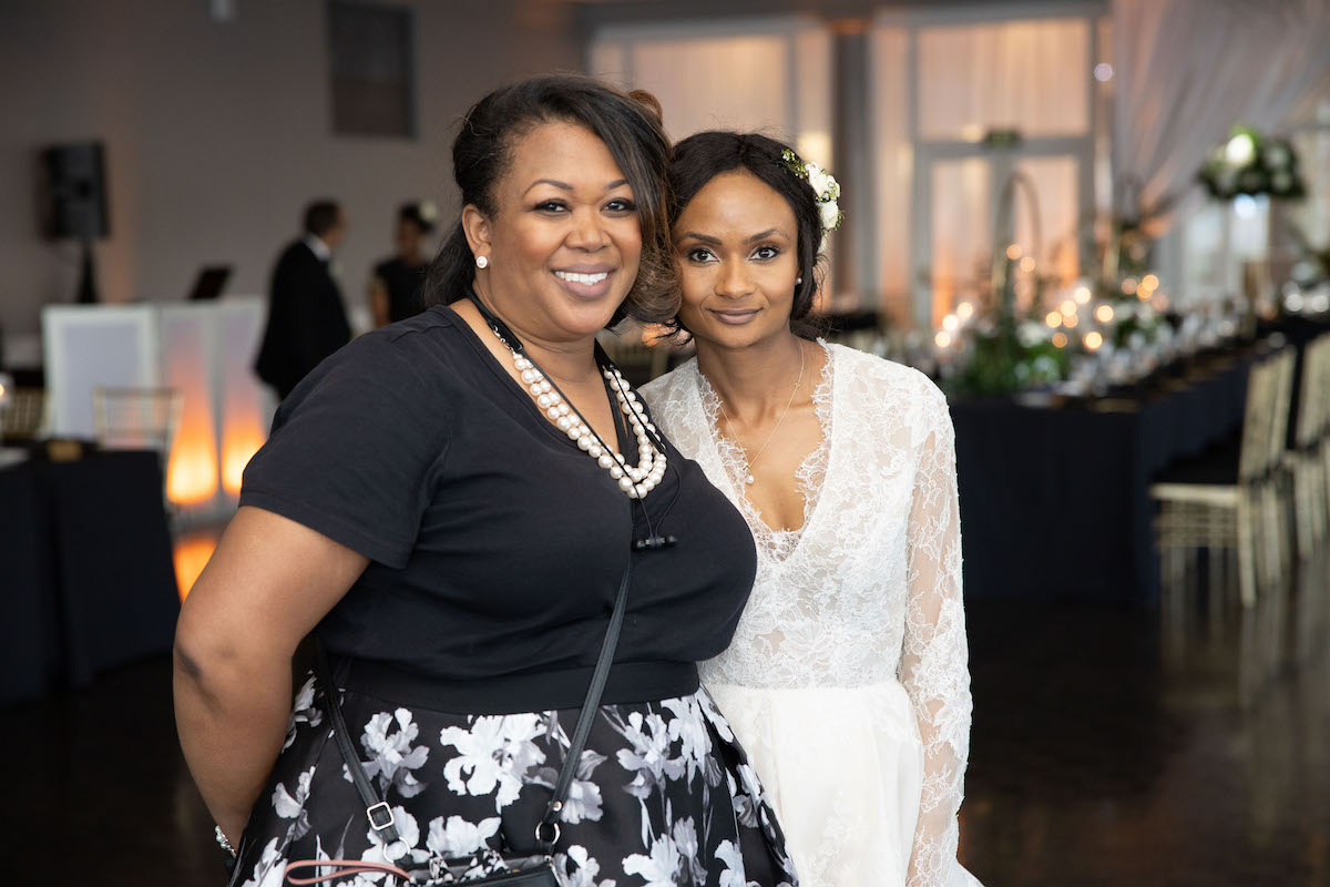 Lorna standing with bride for photo opp