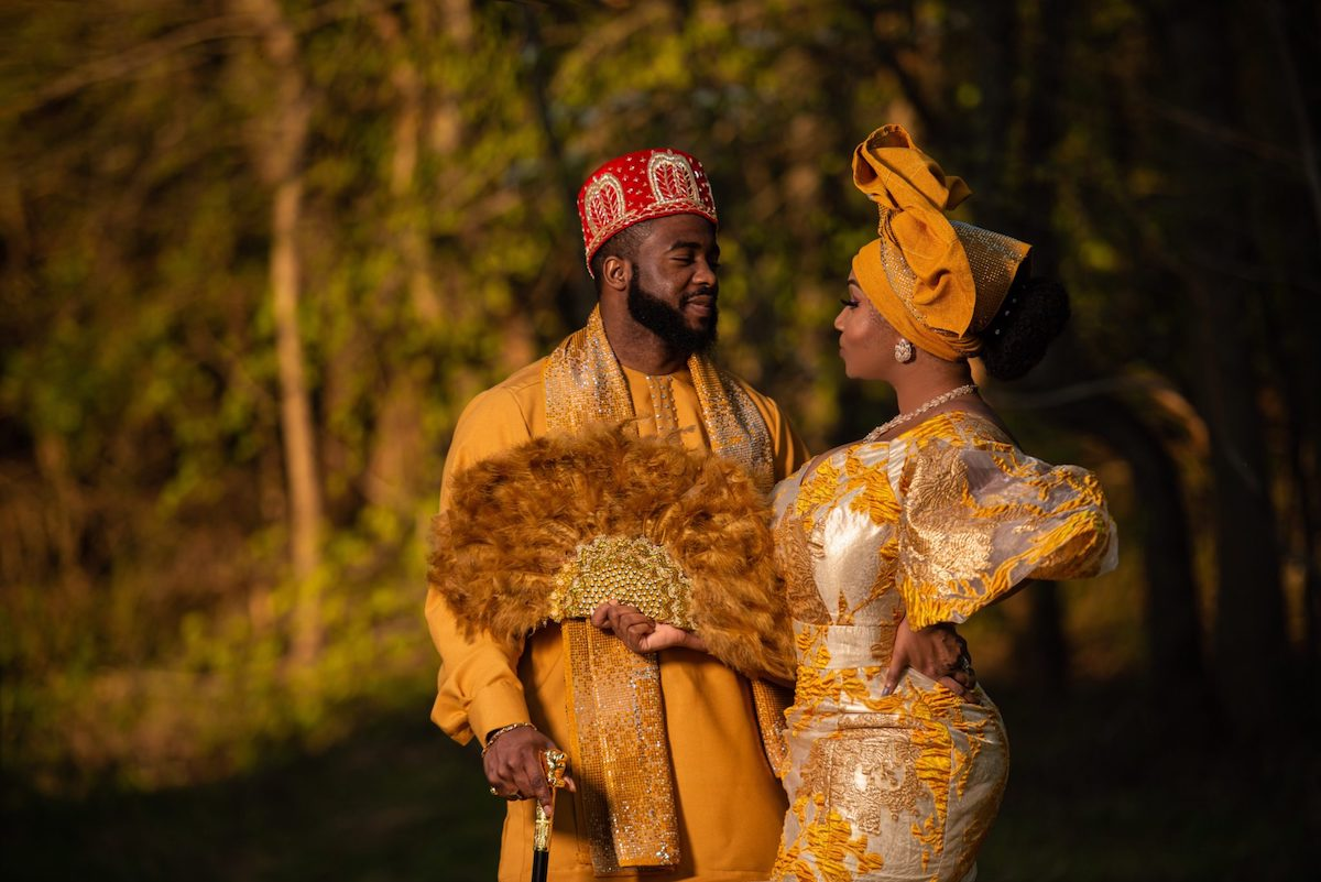 couple in golden colored traditional Nigerian wedding garb