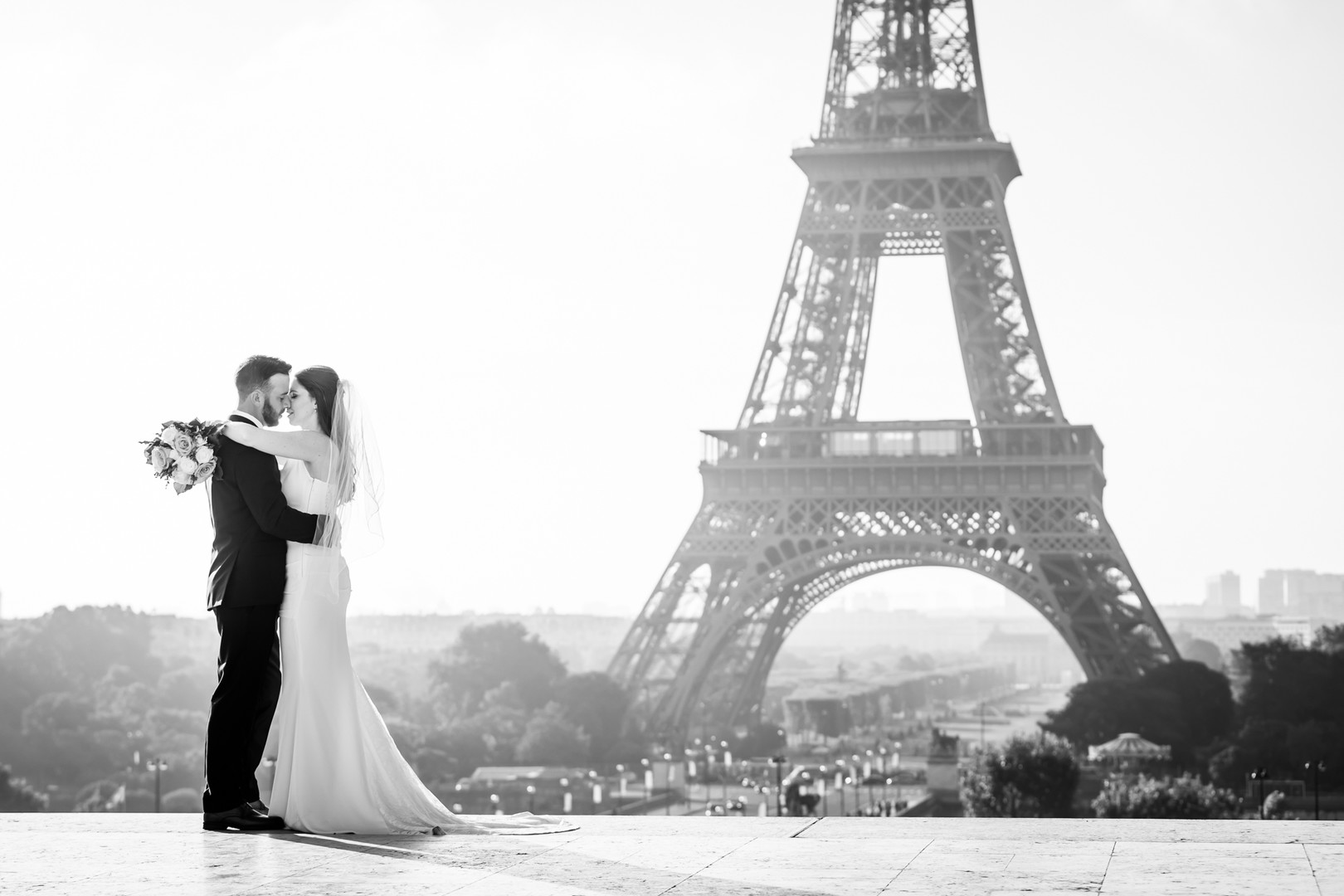 couple hugging in front of Eiffel Tower