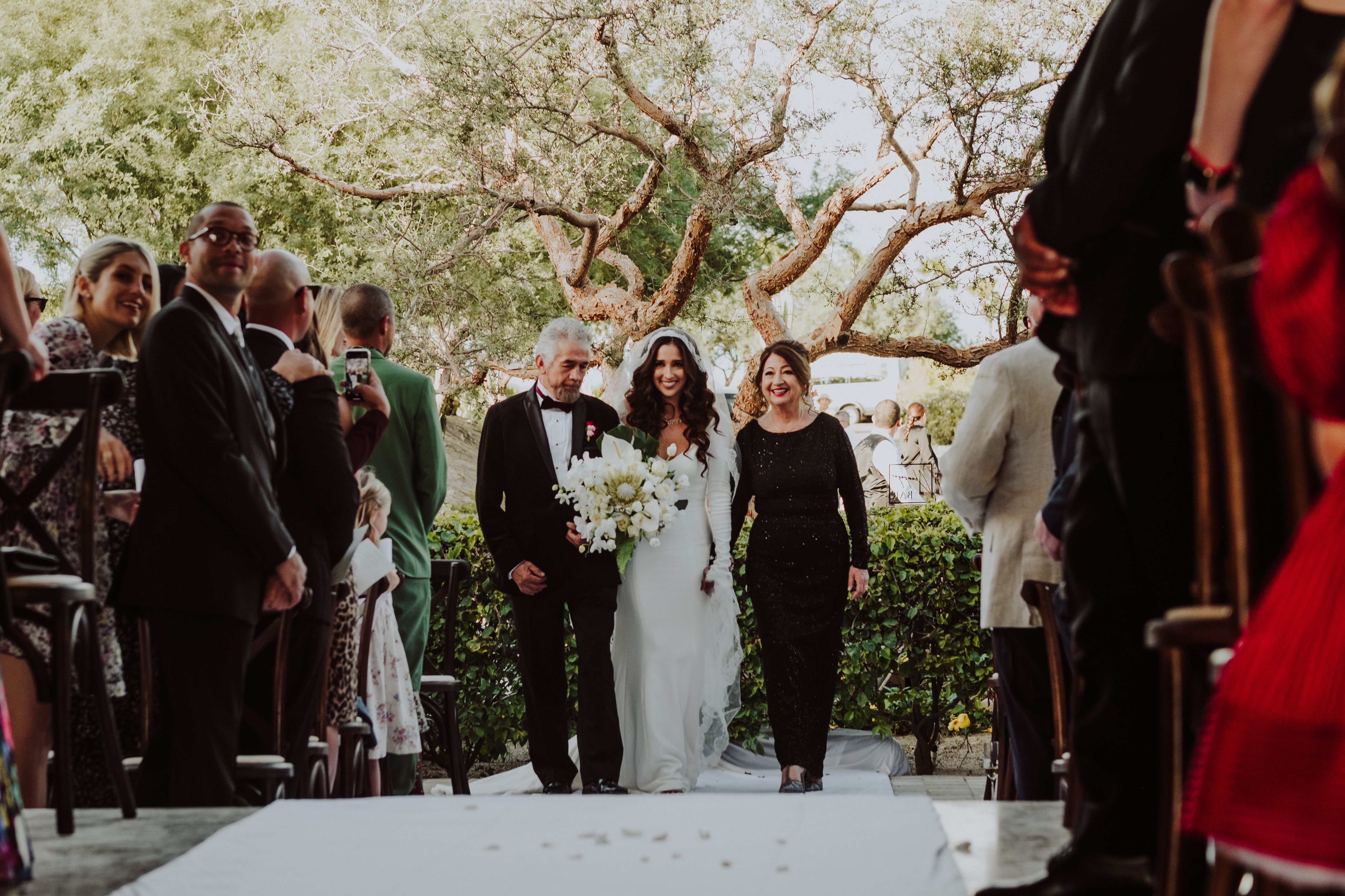 Godparents walking bride down the aisle