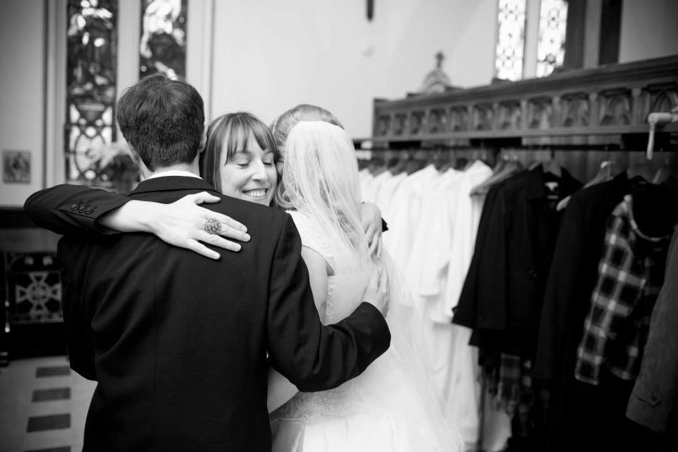 Shannon hugging couple