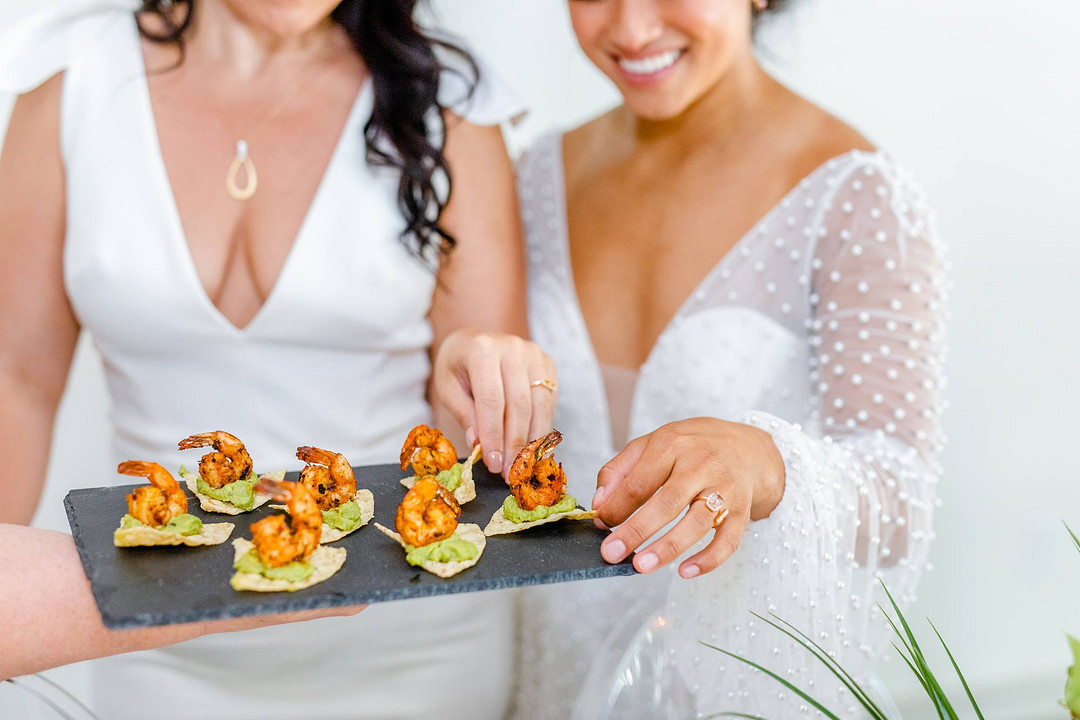 Brides eating shrimp bites