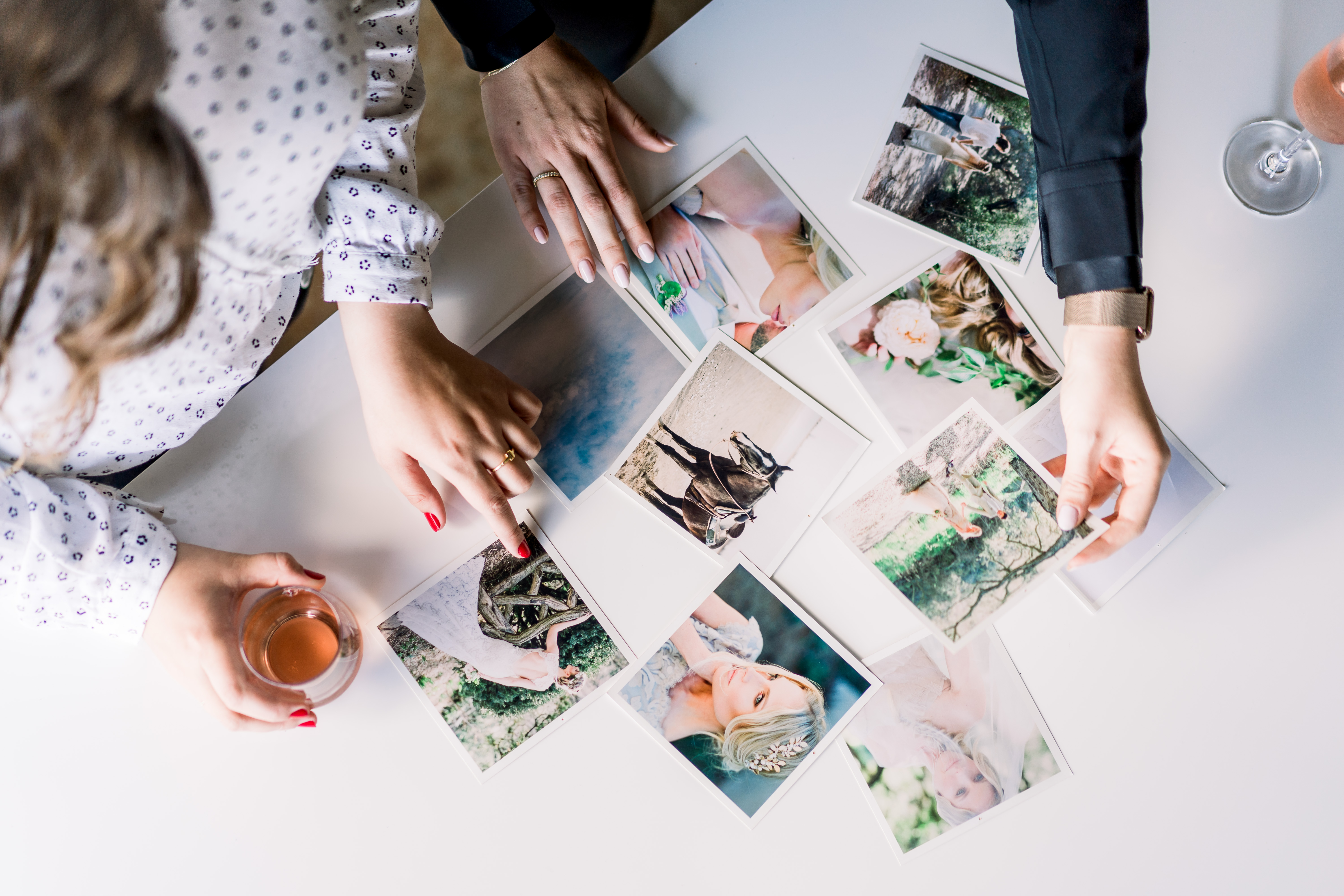 Two people looking at pictures