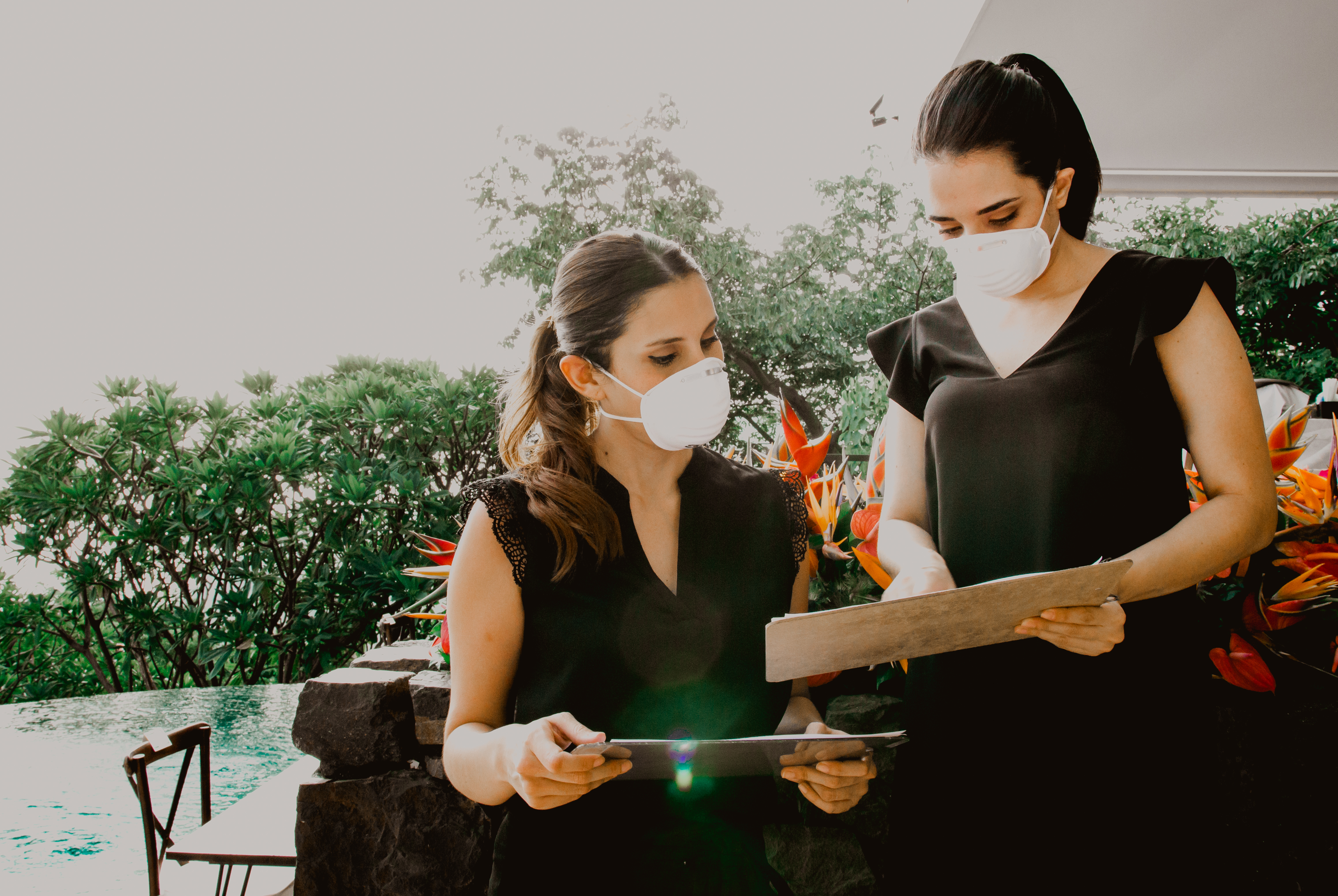 Two event pros wearing masks
