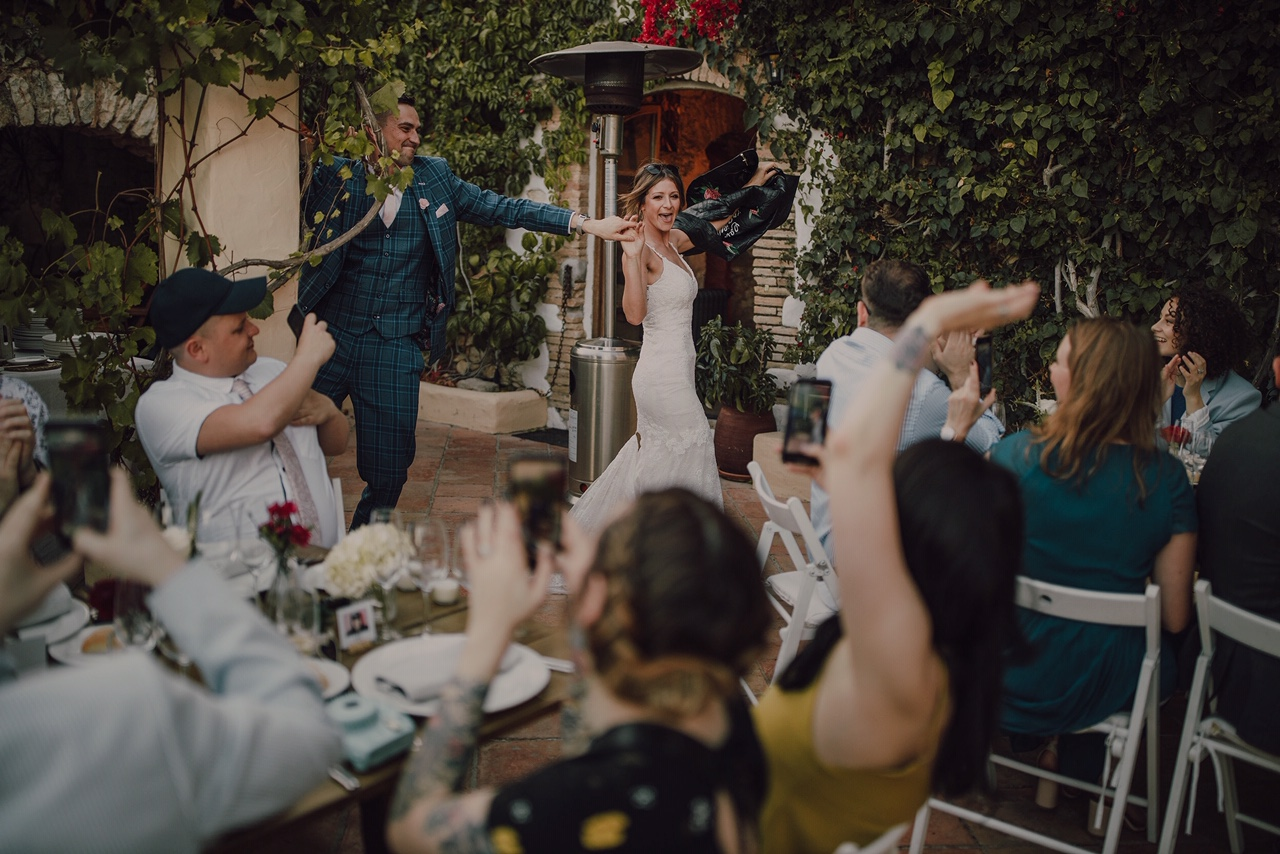 Couple dancing and guests cheering