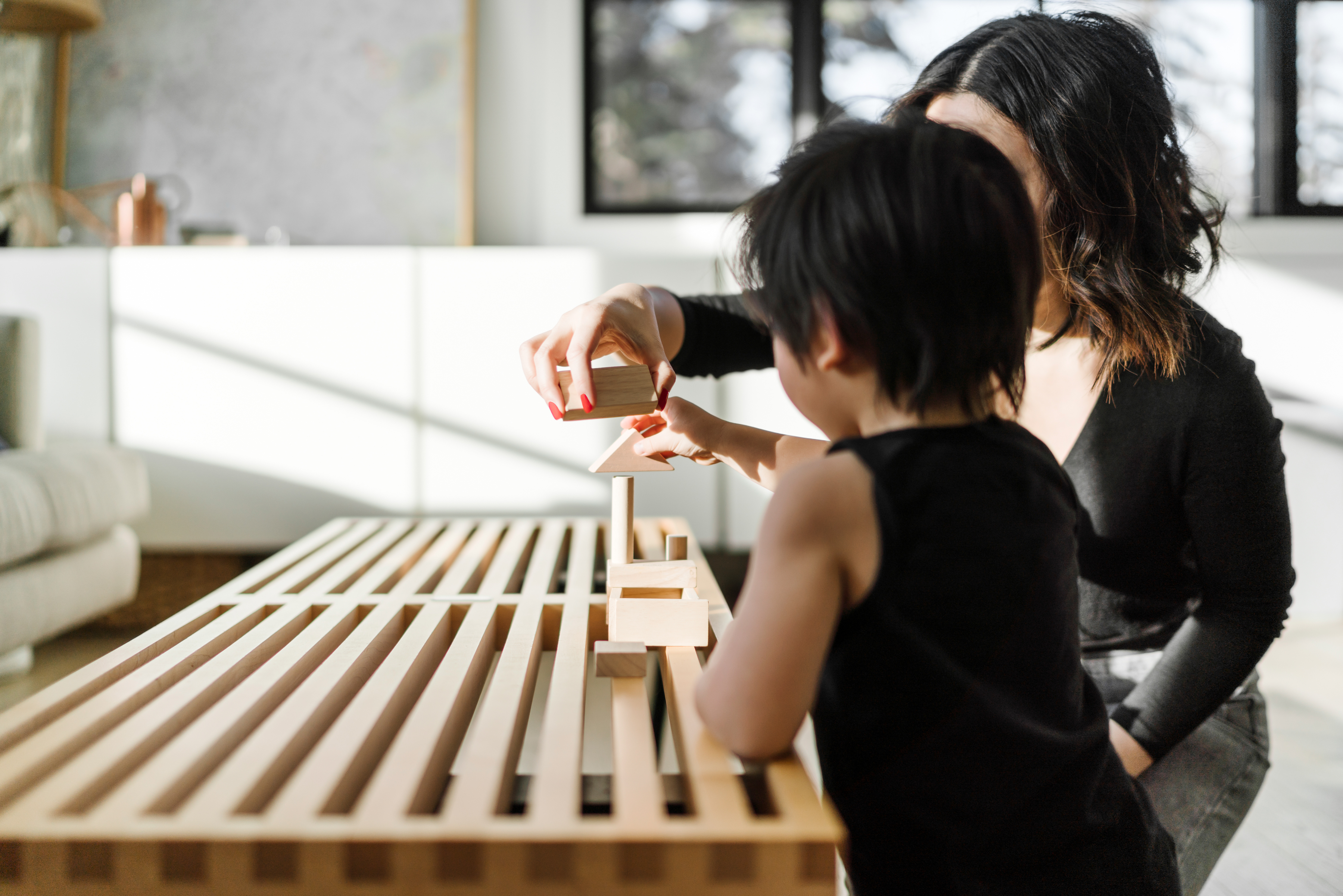 Parent and child playing with blocks