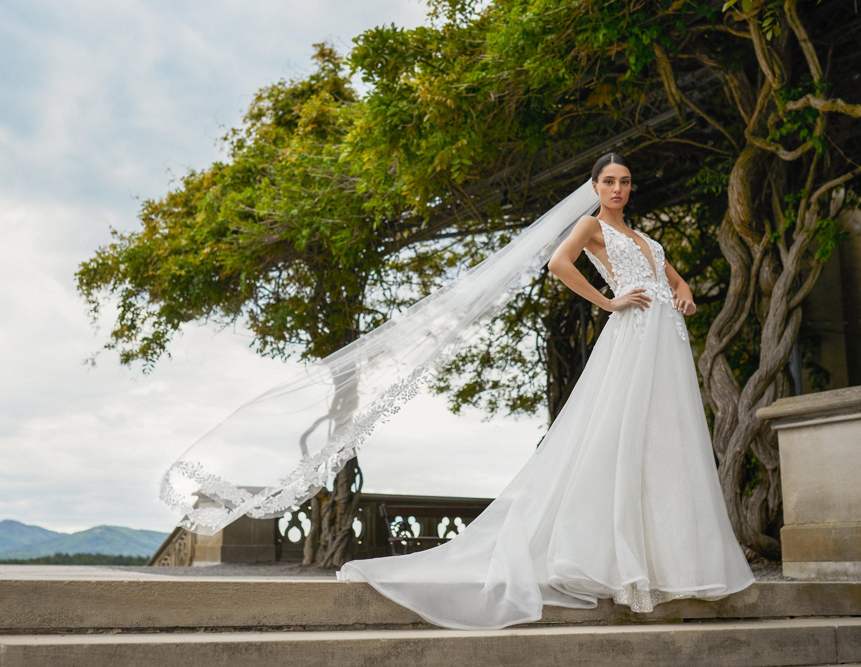 Bride wearing long veil and floor length dress