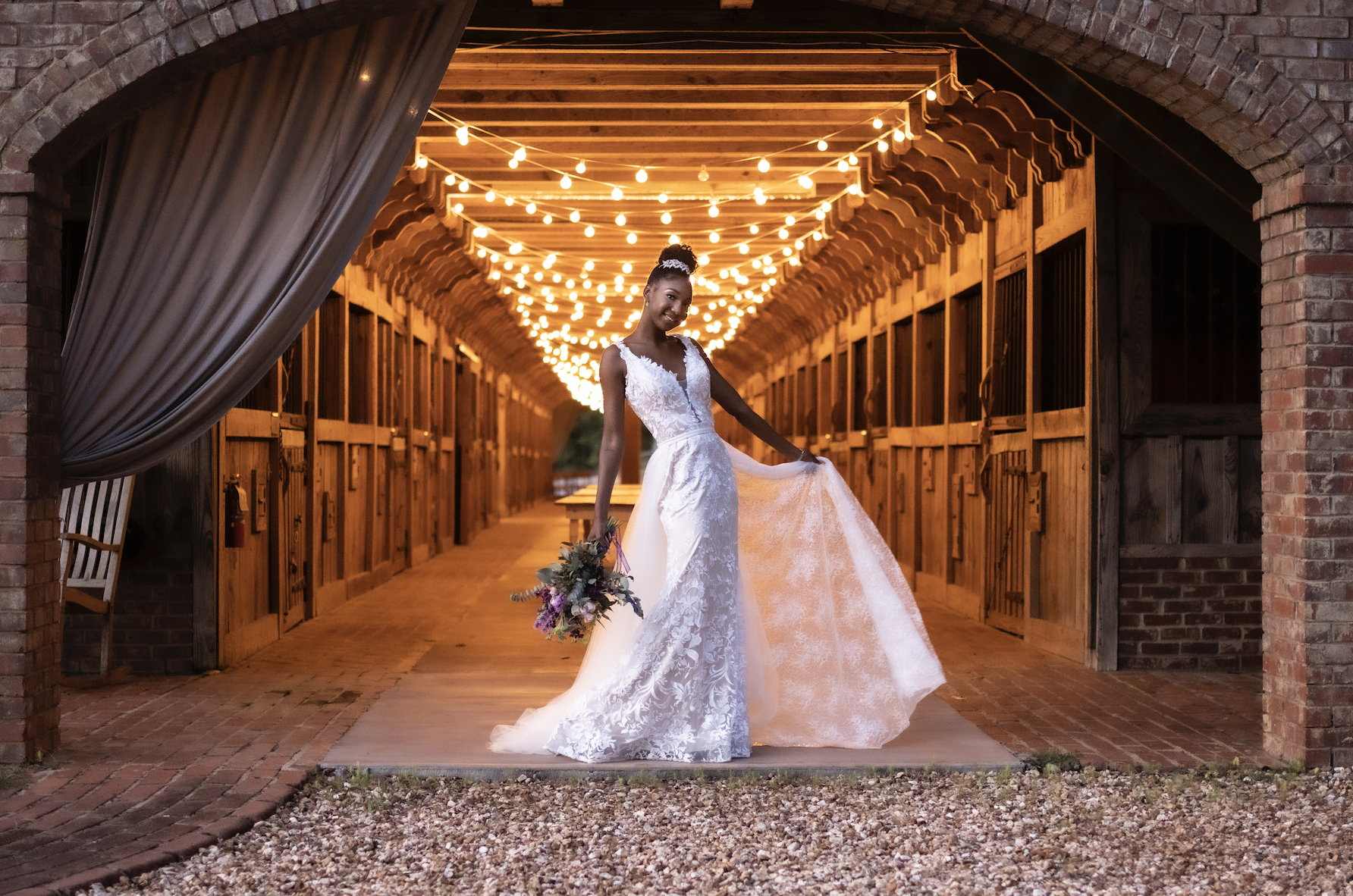 Bride in front of lights in a farm