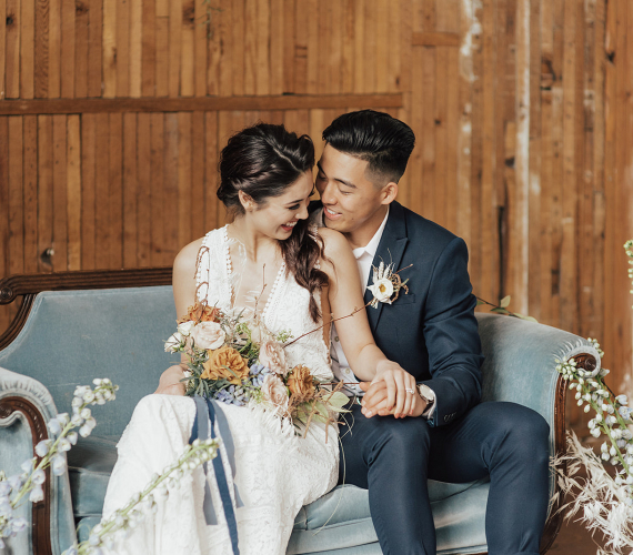 couple on light blue couch surrounded by minimalist boho florals