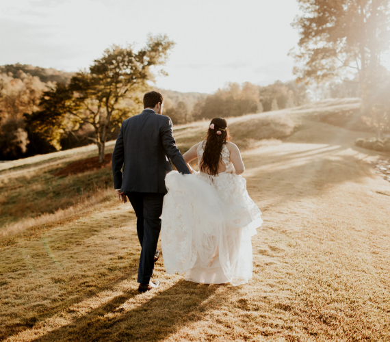 couple running off into sunset