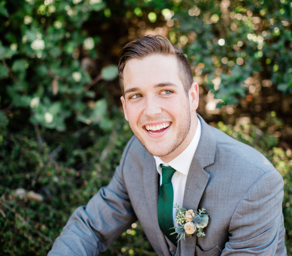 Groom smiling for picture
