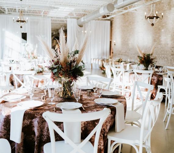 bohemian chic indoor wedding reception setup