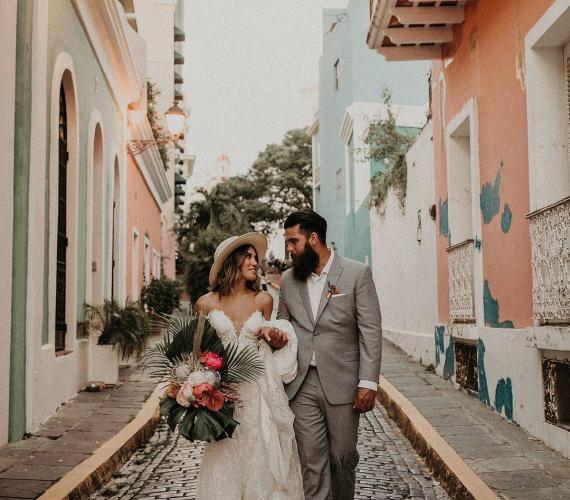 Latin couple walking down a cobble stone road