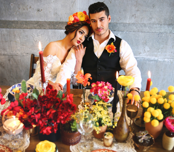 Latin couple surrounded by colorful decor