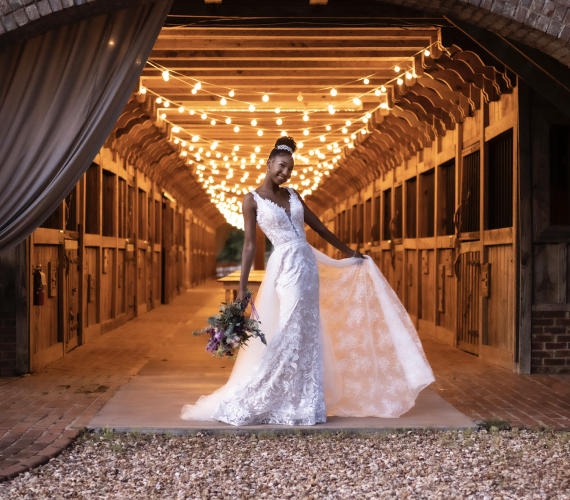 Bride in front of barn