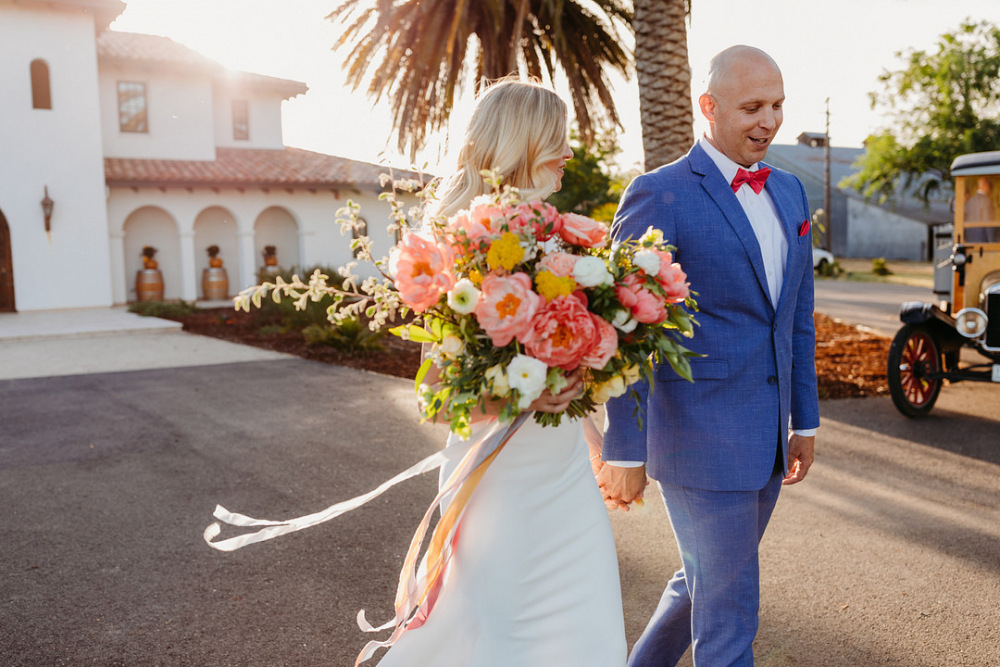 Newlyweds Walking with Bouquet