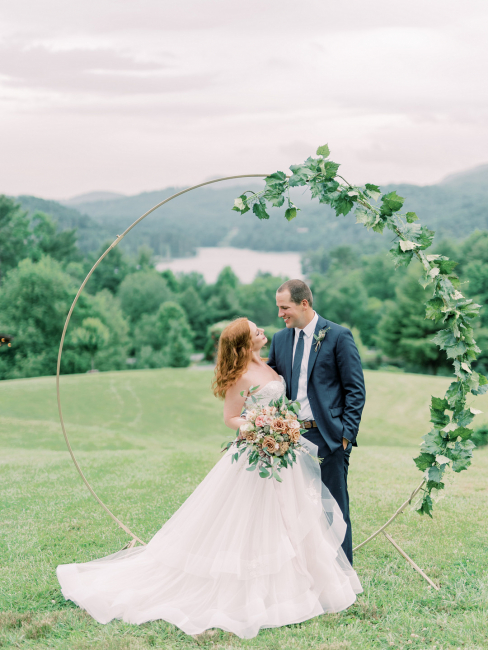 Newlyweds In Front of Circular Arch