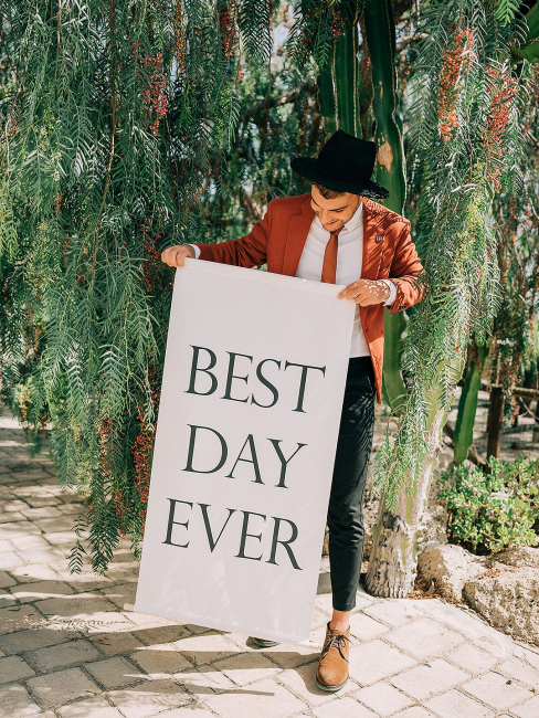 """Groom Holding Sign """"Best Day Ever"""""""