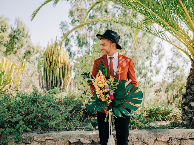 Groom Holding Tropical Bouquet