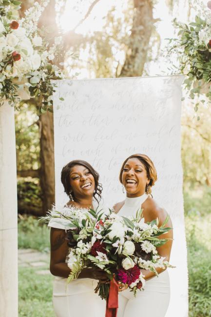 Newlyweds Smiling at Altar