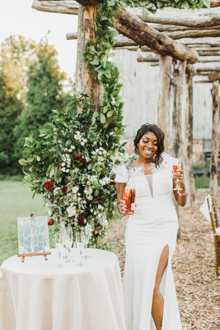 Bride Holding Champagne