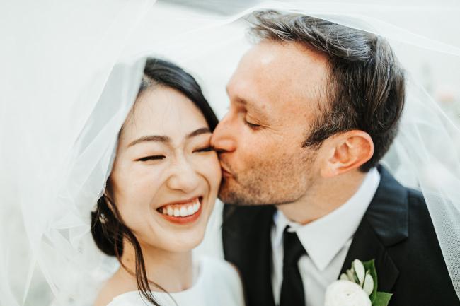 Groom Kissing Bride on Cheek