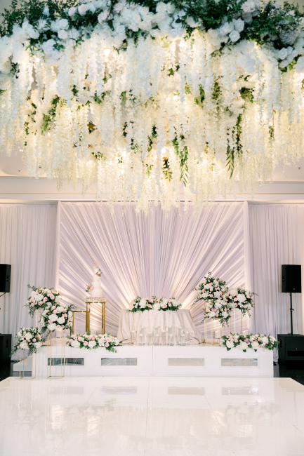 floral chandelier and sweetheart table