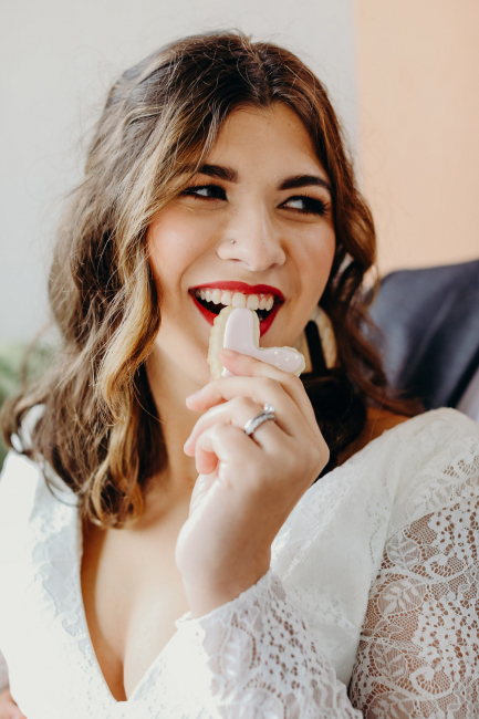 bride eating heart shaped cookie