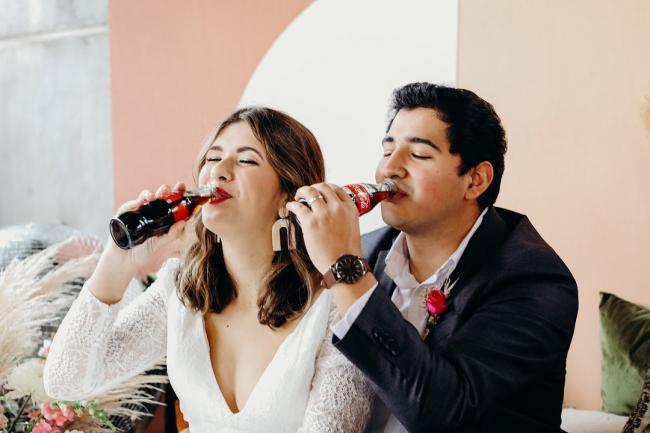couple drinking Coca Cola