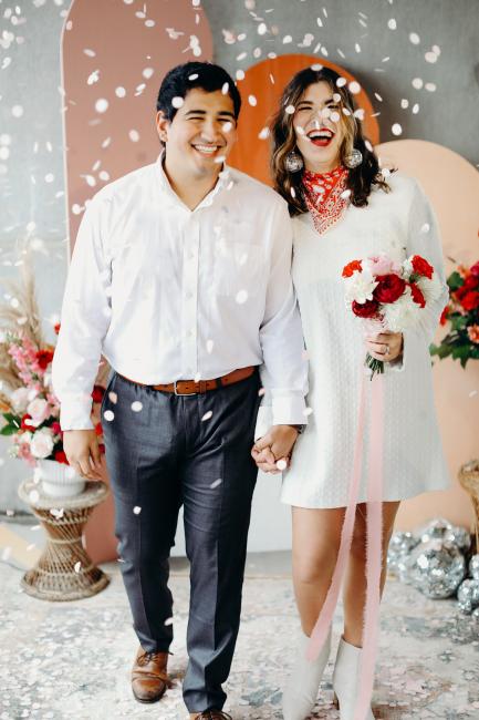 newlyweds showered in cofetti