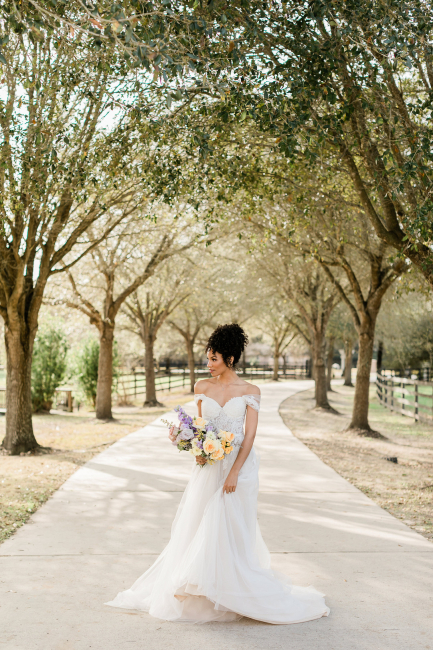 bride holding bouquet outside