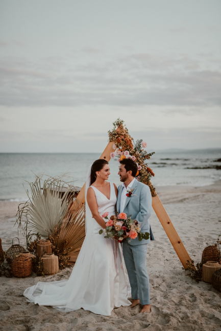 Newlyweds in front of arch