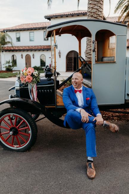 Groom Sitting on Vintage Car