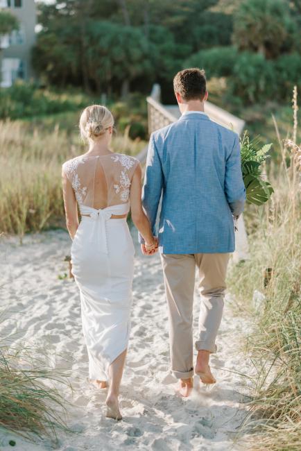 Newlyweds Walking in Sand