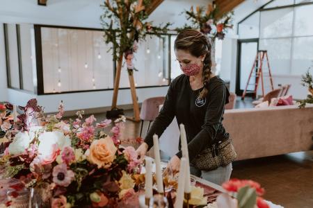 Jillian arranging flowers upon a table