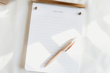 Image of a notepad with a pen on it
