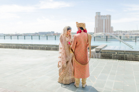 Newlyweds with City in Background